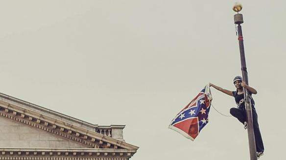Bree-Newsome-takes-down-the-Confederate-Flag-from-a-pole-at-the-Statehouse-in-Co